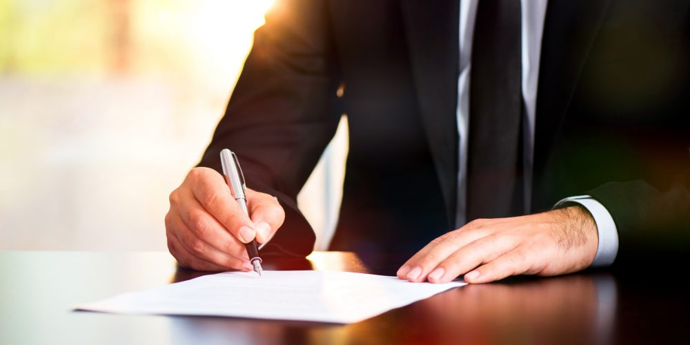 Businessman Signing Legal Document
